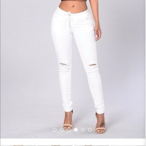Worn once, white pants cut out over the knee